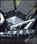 Motorcycle floorboard trim